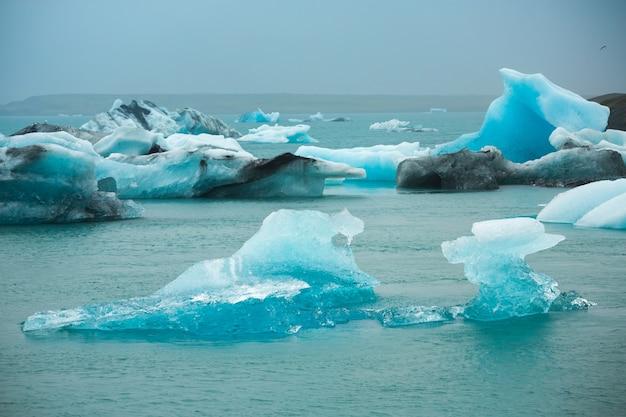 Summer time, icebergs in jokulsarlon glacier lagoon, iceland