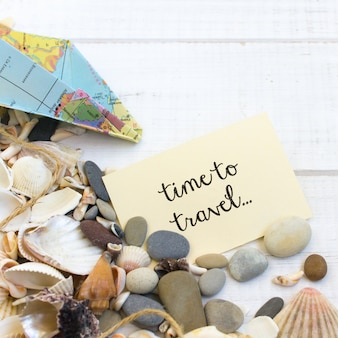 Summer time sea vacation, seashells wooden white background