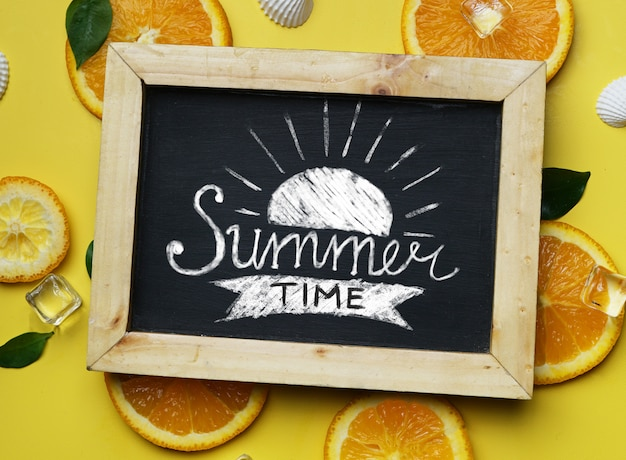 Summer time typography on blackboard on yellow background
