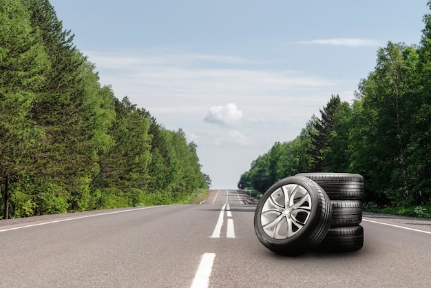 Summer tires and alloy wheels kit on the road. tire change season, auto trade, copy space.