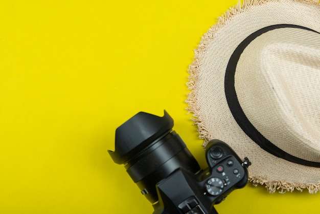 Summer travel accessories on yellow