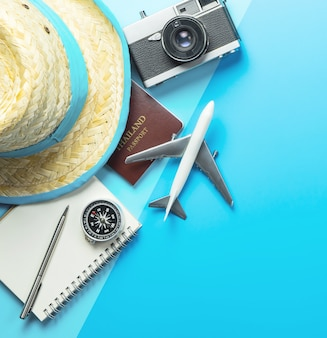 Summer travel blogger accesories on blue shading copy space