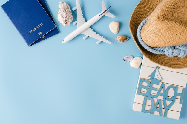 Summer travel concept. decorative airplane, passports, hat and seashells.