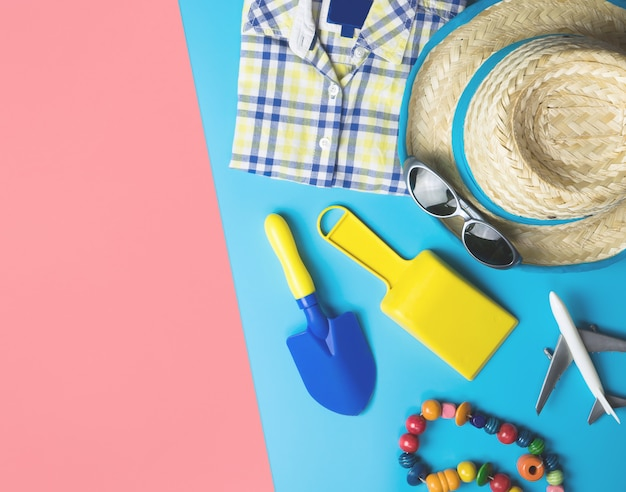 Summer travel fashion for boys on blue pink copy space background