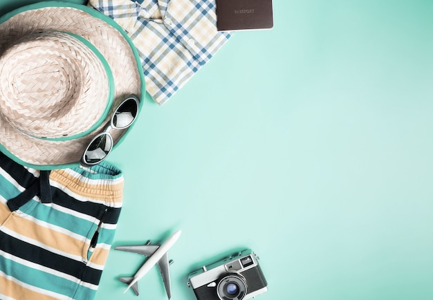 Summer travel fashion for boys on teal copy space