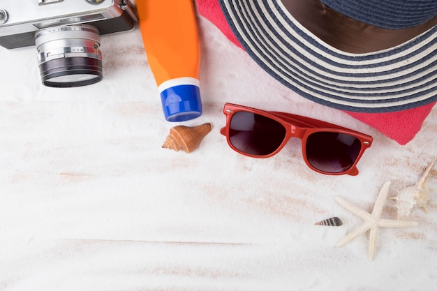 Summer travel. topview white sand beach with summer stuff. hipster style.