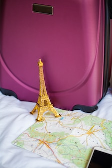 Summer travel vacation. planning vacation and packing travel bag at home or hotel room