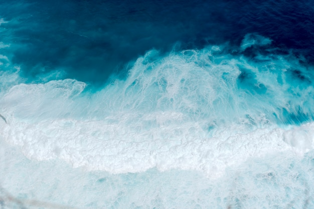 Summer tropical beach blue ocean nature landscape with white wave on tropical summer island.