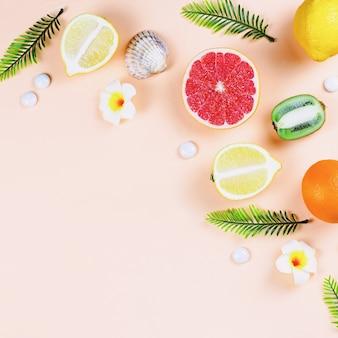 Summer tropical fruits frame on coral color background