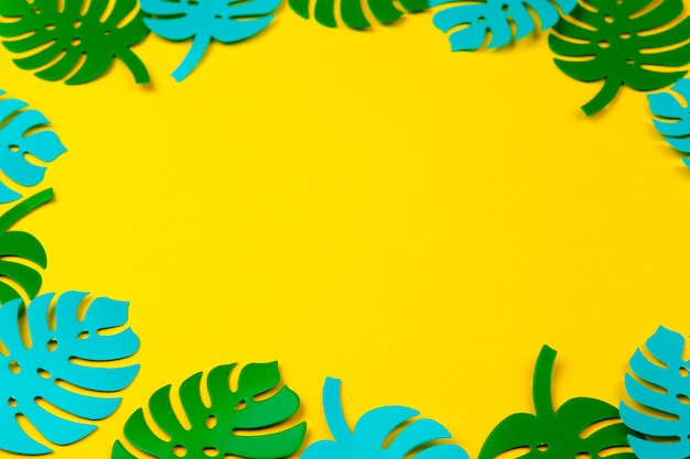 Summer tropical leaves, plants frame background. paper cut style.