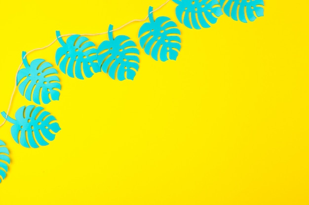 Summer tropical leaves, plants frame. paper cut style.
