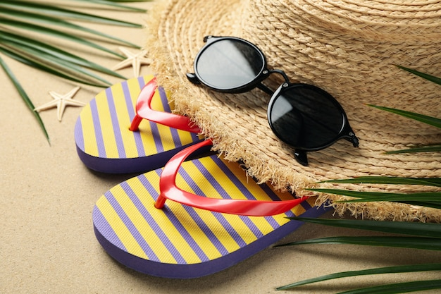 Summer vacation accessories on sea sand, close up