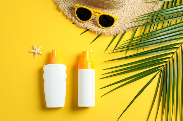 Summer vacation composition on yellow background