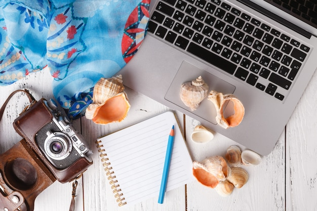 Summer vacation concept, flat lay on white table