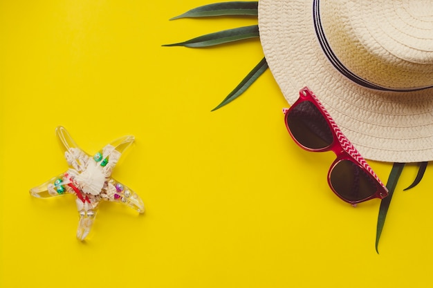 Summer vacation concept flat lay. woman hat top view.