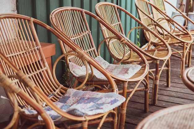 Summer vacation concept : wooden weave brown chairs and table place on street restaurant