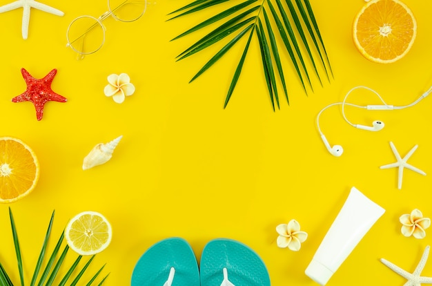 Summer vacation flat lay frame on yellow background