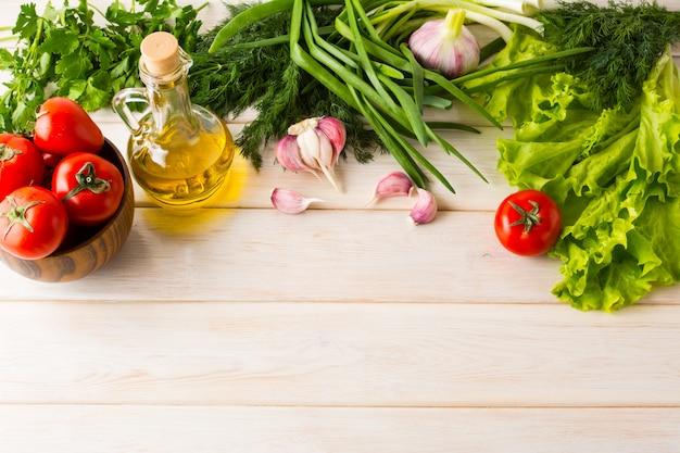 Summer vegetables and olive oil background