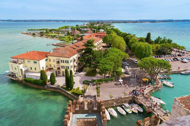 Summer view of small italian town sirmione. italian lake garda and small village.