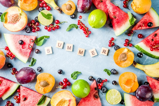 Summer vitamin food concept, various fruit and berries watermelon peach mint plum apricots blueberry currant