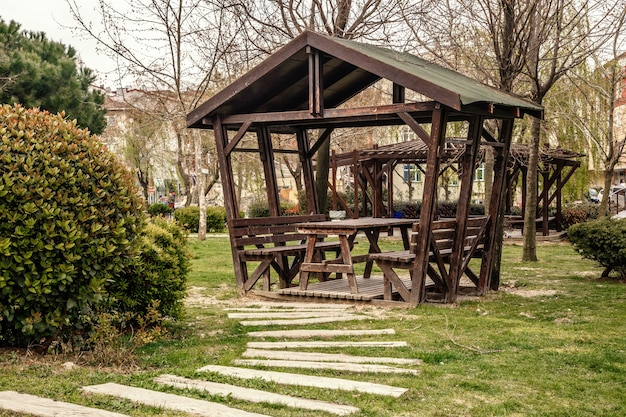 Summer wooden gazebo for rest and picnic in one of the parks of istanbul