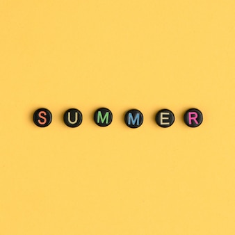 Summer word beads alphabet yellow background