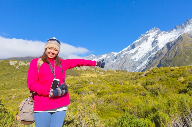 Summertime , asian woman enjoy travel at mount cook national park in south island new zeal