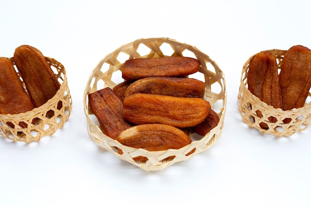 Sun dried bananas on white background.