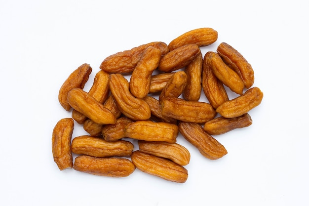Sun-dried bananas on white background.