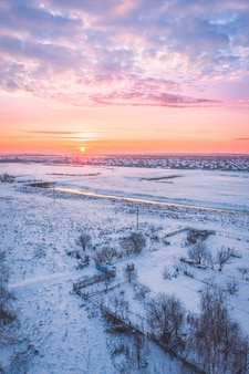 The sun early in the morning at dawn in winter