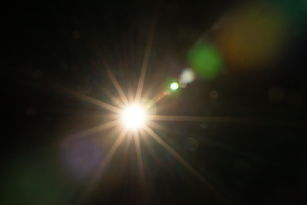 Sun flare on the black background