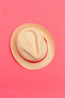 Sun hat on color background.