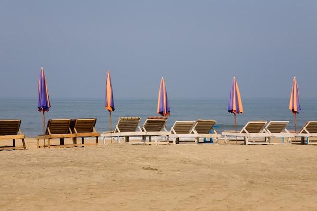 Sun loungeres and  umbrellas