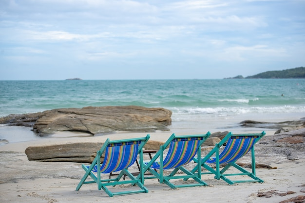 Sun loungers on the beach at koh samet thailand. happy holidays concept