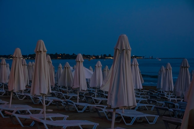 Sun loungers and umbrellas on the beach in the evening
