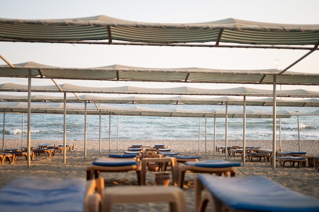 Sun loungers with umbrella on the beach. tourism industry. high quality photo