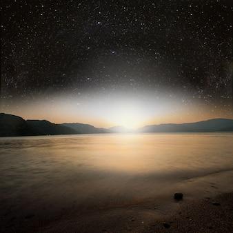 배경 별 하늘에 태양이 바다에 반영됩니다. nasa에서 제공한 이 이미지의 요소