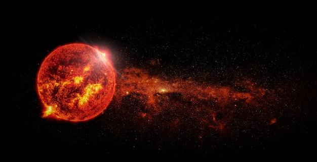 Солнце на фоне пространства. элементы этого изображения предоставлены наса.