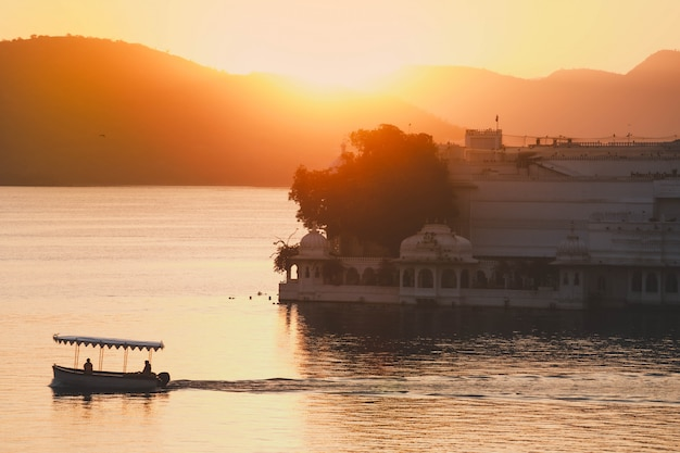 Sun rise in the morning at taj lake palace on lake pichola in udaipur india