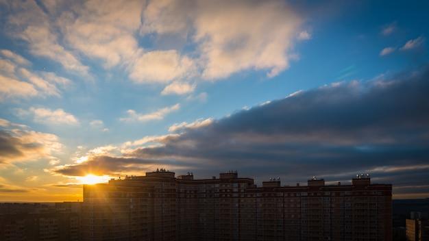 Sun rising over city