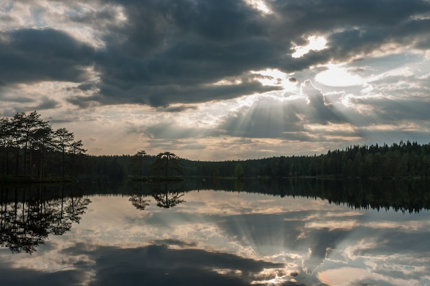 The sun setting over the lake with some interesting clouds in the sky. sweden