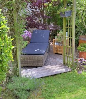Sunbathing on a wooden terrace in a garden