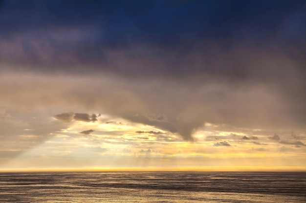 The sunbeam in evening sky and the north sea