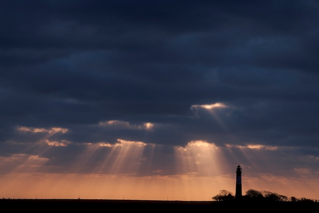 Sunbeams and lighthouse, baltic coast, germany