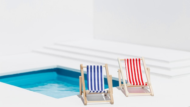 Sunbeds next to small swimming pool