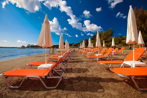 Sunchairs with  umbrellas on beautiful  beach
