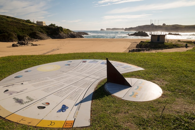 Sundial on a beautiful sunny beach