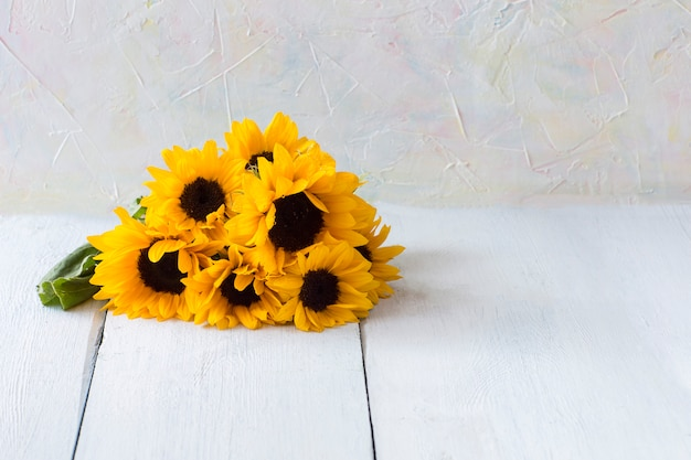 Sunflower bouquet on a wooden table