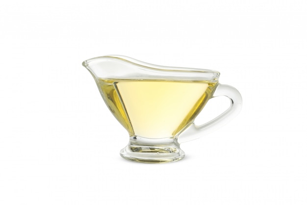 Sunflower oil in gravy boat on white