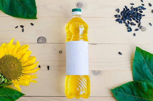 Sunflower oil with flower and seeds in a bottle.